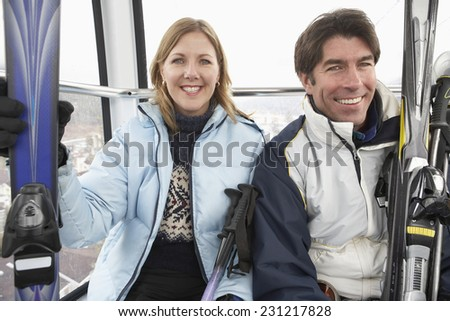 Happy Couple in Aerial Tram - stock photo