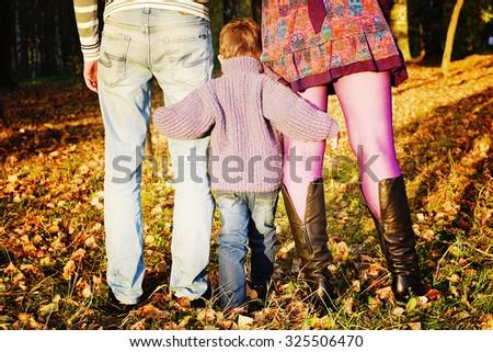 Happy couple in Autumn Park autumn. Family Fun outdoors. - stock photo
