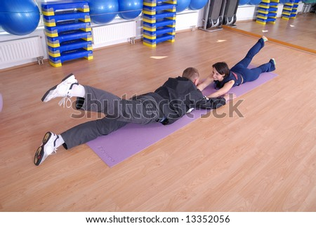 happy couple in fitness studio