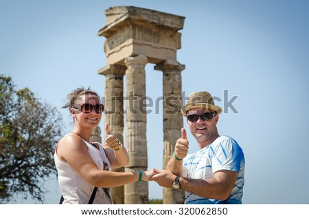 Happy couple in front of Apollo ancient ruins on Rhodes