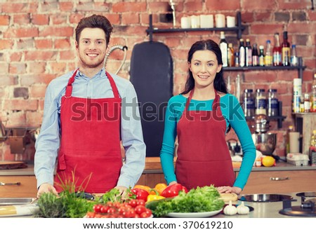 happy couple in kitchen at cooking class - stock photo