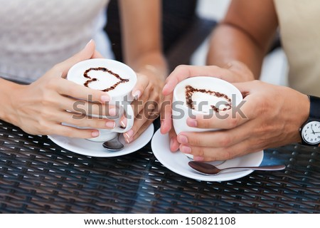 Happy couple in love drinking coffee - stock photo