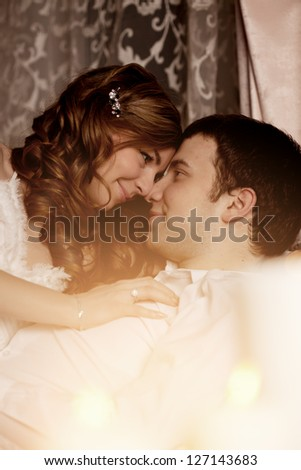 Happy Couple in love hugs at home