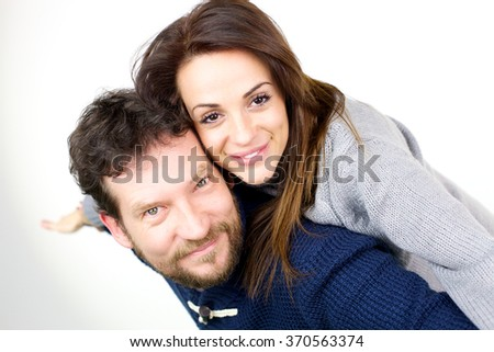 Happy couple in love looking camera