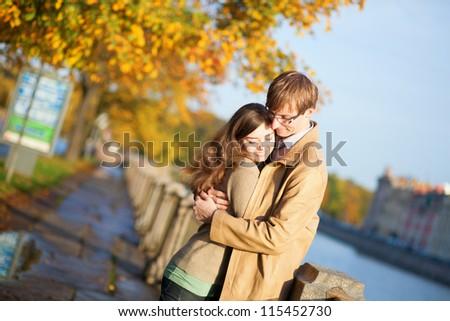 Happy couple in love on the Fontanka embankment in Saint-Petersburg, Russia - stock photo
