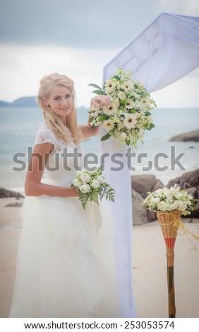 Happy Couple in love on wedding ceremony seaside tropical beach thailand phuket - stock photo