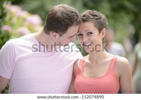 happy couple in love outdoors flirting - stock photo