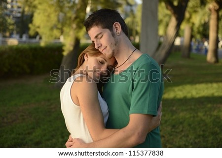 happy couple in love outdoors hugging - stock photo