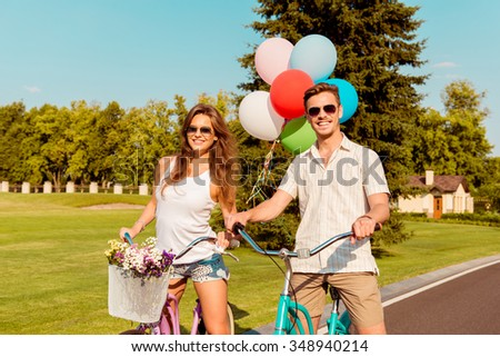 happy couple in love ride bicycles have fun - stock photo