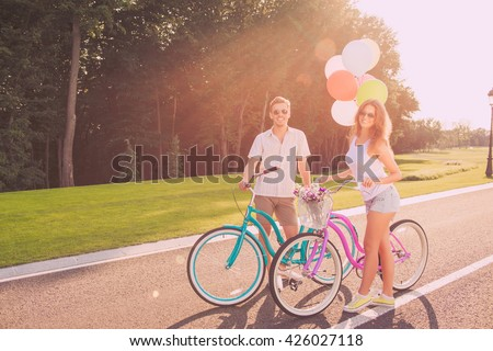 Happy couple in love riding bicycle together - stock photo