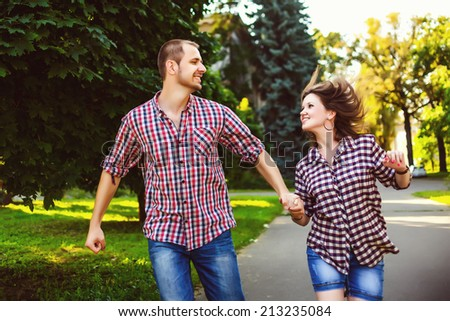 Happy couple in love running at alley. Toned image - stock photo