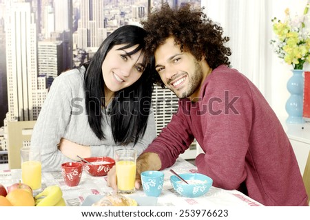Happy couple in love with cereals fruit and coffee