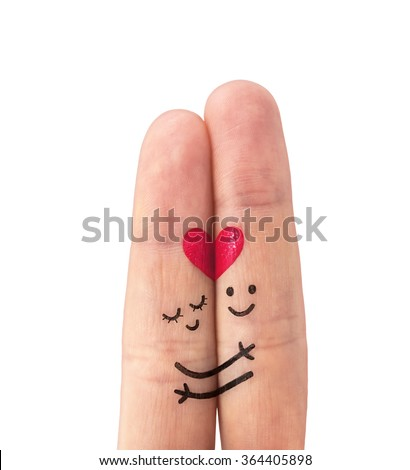 Happy couple in love with painted smiley on a white  - stock photo