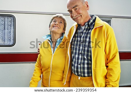 Happy Couple in Matching Sweatsuits - stock photo