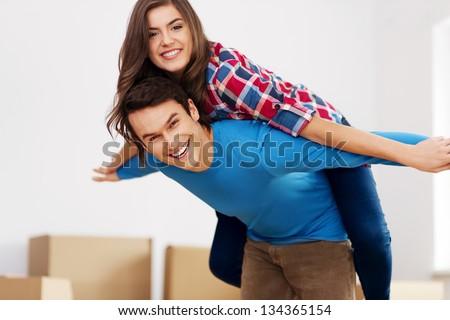 Happy couple in new apartment - stock photo