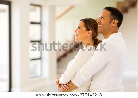 happy couple in new home - stock photo