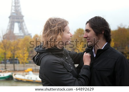 Happy couple in Paris at fall - stock photo