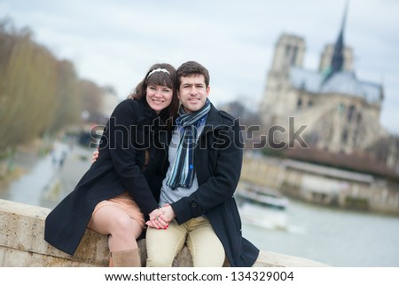 Happy couple in Paris on the Seine embankment - stock photo