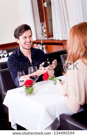 happy couple in restaurant romantic date love dinner valentines day wedding