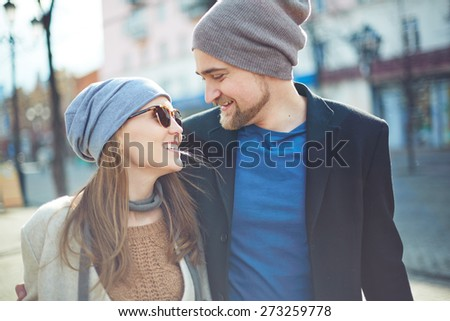 Happy couple in stylish clothes dating outdoors - stock photo