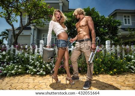 Happy couple in the garden. - stock photo