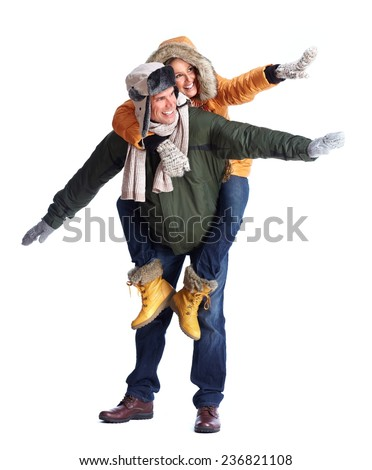 Happy couple in winter clothing isolated on white background - stock photo