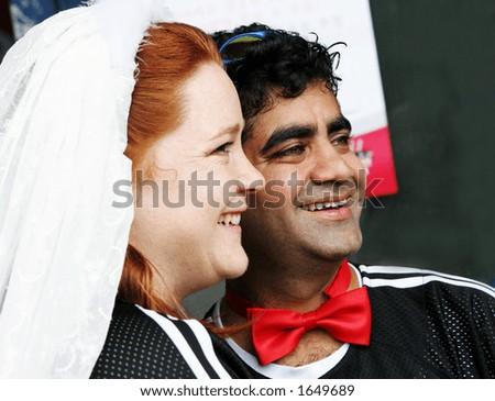 Happy couple - intercultural marriage - stock photo