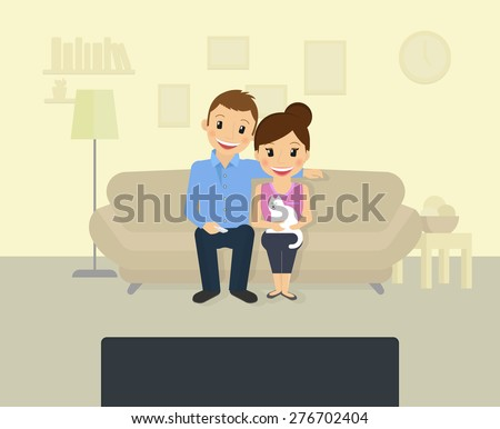 Happy couple is watching tv at home - stock photo