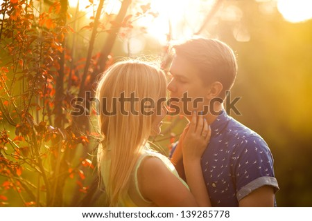 Happy couple kissing in nature