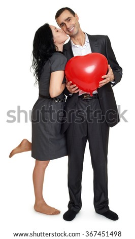 Happy couple kissing portrait. Man hold red heart shaped balloon. Valentine holiday concept