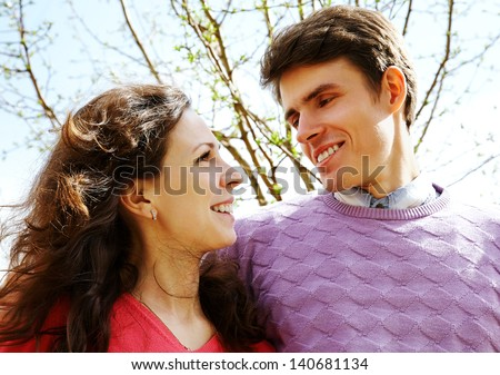 Happy couple looking at each other outdoor - stock photo