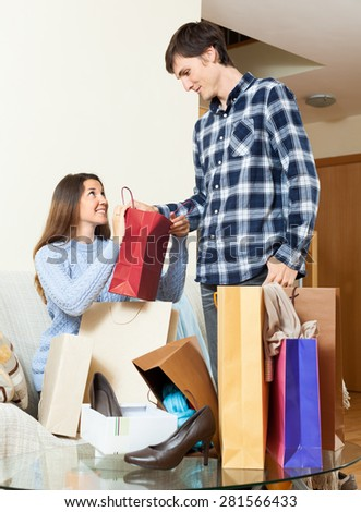 Happy couple looking their  purchases in home