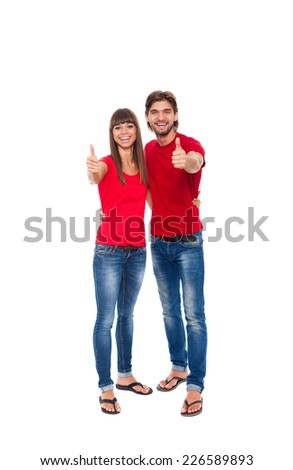 happy couple love excited smiling holding thumb up gesture, beautiful young man and woman smile looking at camera, wear red t shirt isolated over white background