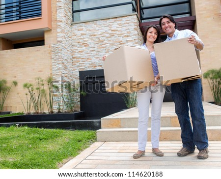 Happy couple moving into a new house - stock photo