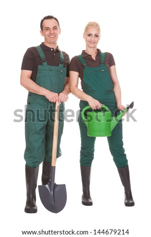 Happy Couple Of Garden Workers Isolated Over A White Background - stock photo