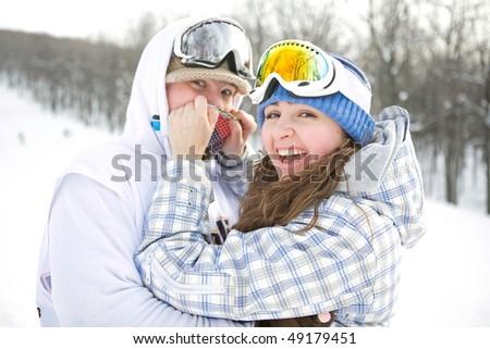 Happy couple of snowboarders - stock photo