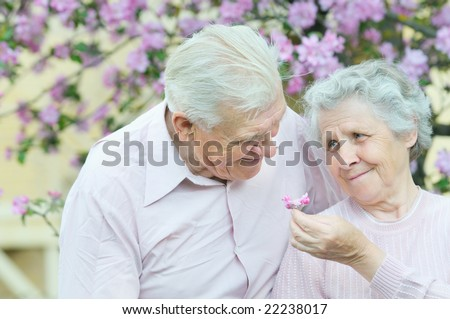happy couple old people on spring background