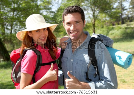 Happy couple on a hiking day - stock photo