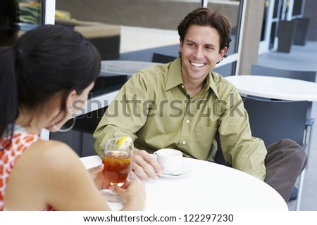 Happy couple on date in outdoor restaurant