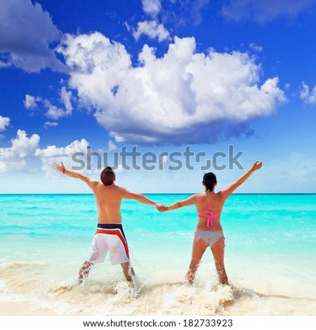 Happy couple on holidays at Caribbean Sea
