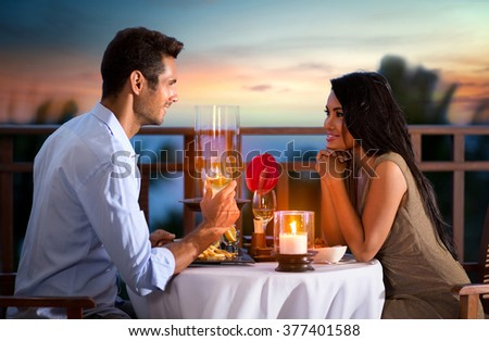 Happy couple on summer evening having romantic dinner outdoor  - stock photo