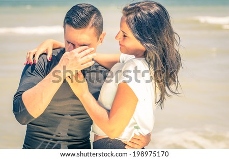 happy couple on the beach,man laughing at his girlfriend joke - stock photo