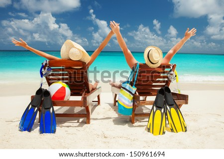 Happy couple on the beach of sea - stock photo