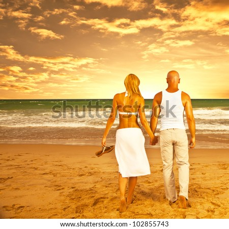 Happy couple on the beach, romantic travel, honeymoon vacation, summer holidays, people walking on sea sunset and holding hands, loving family relaxing outdoor, love concept