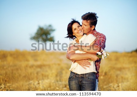 happy couple on the field - stock photo