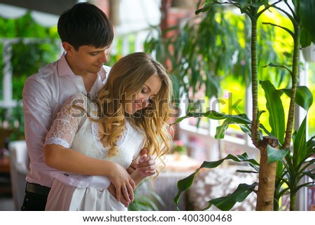 Happy couple on the terrace in the sunny day - stock photo