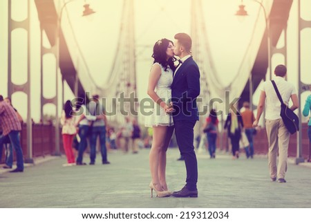 Happy couple on their wedding day on bridge. Bride and Groom. - stock photo
