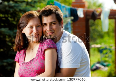 Happy couple outside on a sunny day - stock photo