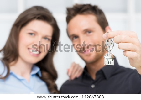 Happy Couple Owner Of New House With Keys - stock photo