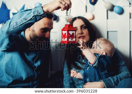 happy couple playing with their little baby - stock photo